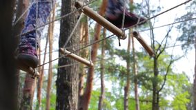 Treetop adventure park. Legs of person in motion. Not afraid of heights stock footage