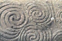 Trefaldig spiral - Newgrange arkivfoton