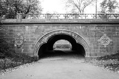 Trefoil arch in Central park under East Drive. The name of Trefoil arch in Central Park (NYC)  indicates the three lobes of its shape Royalty Free Stock Photography