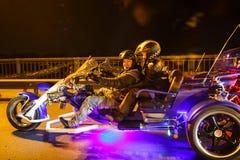 Trehjuling som är ljus i natten Royaltyfri Bild