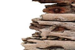 Treibholz mit verrosteten Bolzen stellte gegen eine konkrete Steinwand ein, Weinleseschmutz lokalisiert auf weißem Hintergrund lizenzfreie stockfotos