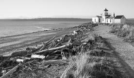 Treibholz-Strand-West Point-Leuchtturm-Kap-Anlegestellen-Entdeckungs-Park lizenzfreie stockfotos