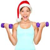 Treinamento da mulher do Natal da aptidão Fotos de Stock