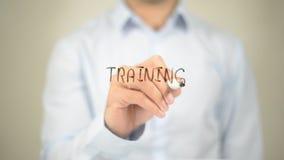 Treinamento, escrita do homem na tela transparente Fotos de Stock Royalty Free