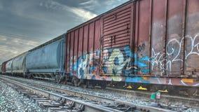 Treinauto's en spoor Royalty-vrije Stock Foto's