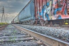 Treinauto's en spoor stock afbeeldingen