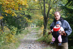 Trek. Autumn walk in the mountains with a child in a baby sling stock photography