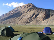 Trek Campsite. Tents pitched in a dry river bed stock photo