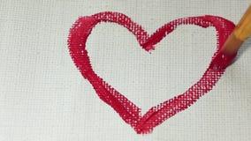 Trek een hart met een borstel op het canvas stock videobeelden