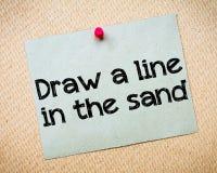 Trek een lijn in het zand royalty-vrije stock foto