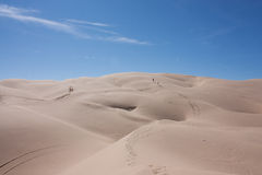 Treking across the desert Royalty Free Stock Photography