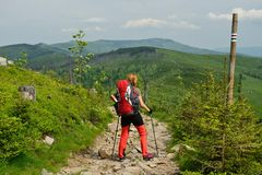 Treking in the mountains with the backpack in Poland. Hikings along tourist trails in the mountains Beskid in Poland with the backpack on the back Stock Photo
