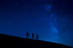 Treking at night. People trekking at night with stars and milky way Stock Photography