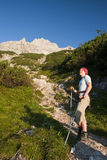Treking woman. Woman in the summer Alps Royalty Free Stock Photo