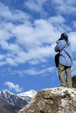 Trekker Admiring The View. Lonely trekker admiring mountain view in Pakistan royalty free stock images