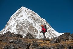 Trekker approaching PumoRi mountain in Khumbu valley on a way to. Everest Base camp Stock Photos