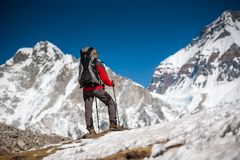Trekker approaching PumoRi mountain in Khumbu valley on a way to. Everest Base camp Stock Photo