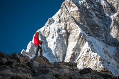 Trekker approaching PumoRi mountain in Khumbu valley on a way to. Everest Base camp Royalty Free Stock Image