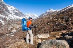 Trekker approaching Renjo La pass on a way to Everest Base camp Stock Image