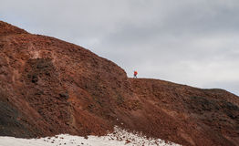 Trekker ascending Modi mountain during Fimmvorduhals trek in Iceland Stock Photos