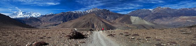 Trekker with backpack on the road in Lower Mustang Royalty Free Stock Images