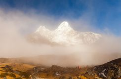 Trekker below Ama Dablam in the Nepal Himalaya Stock Photos