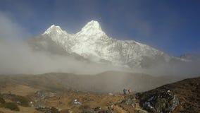 Trekker below Ama Dablam in the Nepal Himalaya.  stock video