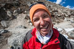 Trekker with burned skin on face is smiling at camera in Khumbu. Valley on a way to Everest Base camp Stock Images