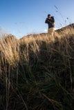Trekker with camera stock photo