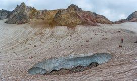 Fuss Peak Volcano, Paramushir Island, Russia. Trekker at crater of Fuss Peak Volcano, Paramushir Island, Kuril Islands, Russia Stock Images
