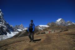 Trekker  beside of everest basecamp from everest trek Royalty Free Stock Images