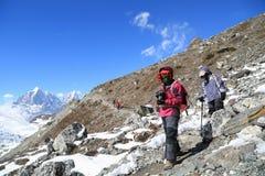 Trekker  beside of everest basecamp from everest trek Stock Photography