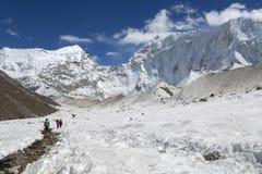 Trekker  beside of everest basecamp from everest trek Stock Photos