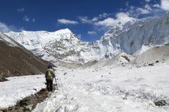 Trekker  beside of everest basecamp from everest trek Stock Images