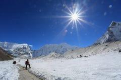 Trekker beside of everest basecamp from everest trek nepal Royalty Free Stock Photography