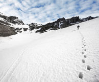 Trekker and footprints in the snow. Ushuaia is the southernmost city in the world, Argentina Royalty Free Stock Photography