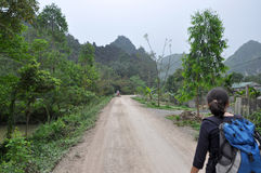 Trekker girl visiting the rural area of Ninh Binh, Vietnam Stock Image