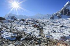 Trekker on glacier beside of everest basecamp from everest trek Stock Photography