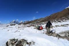 Trekker on glacier beside of everest basecamp from everest trek Royalty Free Stock Images