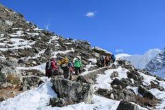 Trekker on glacier beside of everest basecamp from everest trek Royalty Free Stock Photos