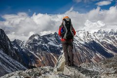 Trekker goes down fron Larke La pass on Manaslu circuit trek in. Nepal royalty free stock image