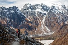 Trekker goes down fron Larke La pass on Manaslu circuit trek in. Nepal royalty free stock photography