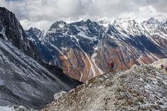 Trekker goes down fron Larke La pass on Manaslu circuit trek in. Nepal stock photos