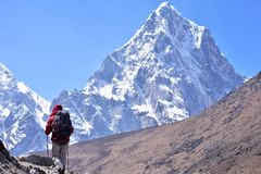Trekker at high Himalaya mountain Royalty Free Stock Images
