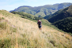 Trekker hiking in the mountains Stock Photos