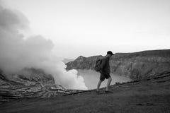 Trekker on Ijen volcano. Black and white Stock Images