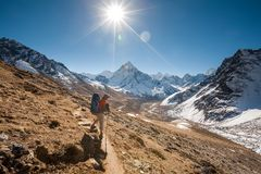 Trekker in Khumbu valley in front of Abadablan mount on a way to. Everest Base camp Royalty Free Stock Photos