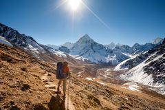 Trekker in Khumbu valley in front of Abadablan mount on a way to. Everest Base camp Royalty Free Stock Images