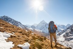 Trekker in Khumbu valley in front of Abadablan mount on a way to. Everest Base camp Royalty Free Stock Photo