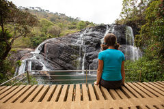 Trekker looks at wild waterfall in Horton Plains National Park Stock Photography